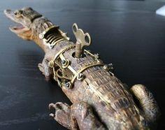 A wind-up taxidermy alligator