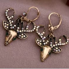 ADORABLE Deer Head Earrings ADORABLE Bronze Alloy Deer Head Pierced Earrings with crystals. Great addition to your collection Boutique Jewelry Earrings
