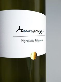 The logo is based on the signature of the grandfather and it had to go  through some long process to achieve its readability. It is composed of  two parts - a fixed one/the free hand Manaresi and line, and a dynamic  one/the typed subtitle. that can either indicate the winery's  description or the wine name specification.