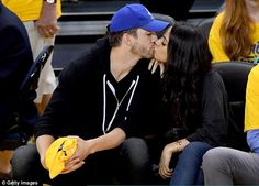 Sharing a sweet moment: Ashton Kutcher and wife Mila Kunis puckered up for the kiss cam during game two of the NBA Finals on Sunday