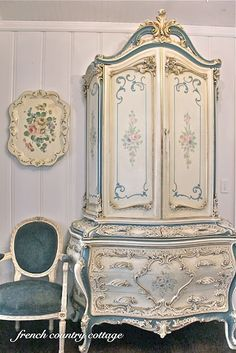 gorgeous french cabinet reminds me of Beauty and The Beast :)