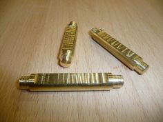The pins are made from soft brass rod milled at the router table.