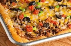Taco Pizza (Using Reduced-Fat Crescent Rolls) Recipe: It's like Mexican layered dip without the chips! | via @SparkPeople