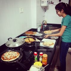 The #GupteKitchen #Pizza assembly line on New Year's eve :)