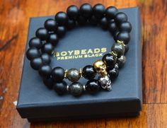 """Reflection"" by BOYBEADS natural 10mm matte black onyx goldtone brass skull beaded bracelet for guys"