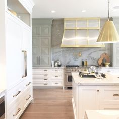 kitchen with stainless and brass hood