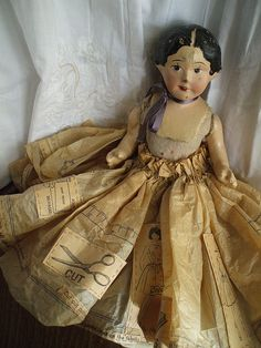 paper skirt Gather my small dolls and dress and embellish them.