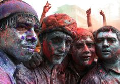 Men smeared with facepaint and colored powder pose for a picture during Holi in the northeastern Indian city of Guwahati on March 1, 2010. (REUTERS/Utpal Baruah)
