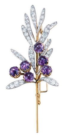 *One of Tiffany's exquisite floral creations, a spray brooch by René Lalique (c. 1894). Composed of 12 platinum leaves set with diamonds, and six rose-cut amethysts set in gold.