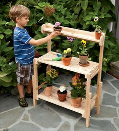 Such a cute Potting Bench! would be cute on the deck or in playhouse for girls'