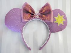 Rapunzel Princess Inspired Mouse Ears Headband, Custom Ears on Etsy.  https://www.etsy.com/listing/216086661/rapunzel-princess-inspired-mouse-ears?ref=sr_gallery_18&ga_search_query=mickey+ears+headband&ga_page=7&ga_search_type=all&ga_view_type=gallery