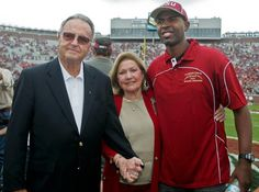 Former Florida State head coach Bobby Bowden, his wife Ann, and FSU's Heisman Trophy winning former quarterback Charlie Ward pose before the start the game against Syracuse Saturday. The Florida State 1993 National championship team was honored before the game. (Phil Sears/AP)