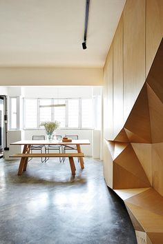 Having moved from a 1,000sqft space into a larger, 1,200sqft five room flat, the couple designed a dramatic television console that double as a storage solution.