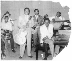 The Aces, from left to right, were Eli Toscano (behind the drummer), Eugene Lyons, Louis Myers, Dave Myers, Willie Dixon, and Freddie Hall (seated at the piano). probably Chicago.