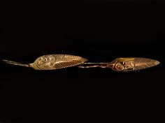 """Gold Eagle Earring, with Sheperd hooks. Made of 14kt gold, by Ron Sebastian, a Gitksan artist.  Measuring 1 X 0.25"""". Northwest Coast First Nations Jewelry."""