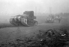 British Medium Mark A Whippet tanks advance past the body of a dead soldier, moving to an attack along a road near Achiet-le-Petit, France, on August 22, 1918. The Whippets were faster and lighter than previously deployed British heavy tanks. (National Library of New Zealand)