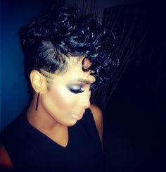 Frohawk with curly hair and shaved sides