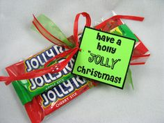 "3 Jolly Rancher Sticks in a cellophane bag with a tag that reads, ""Have a holly jolly Christmas!"""