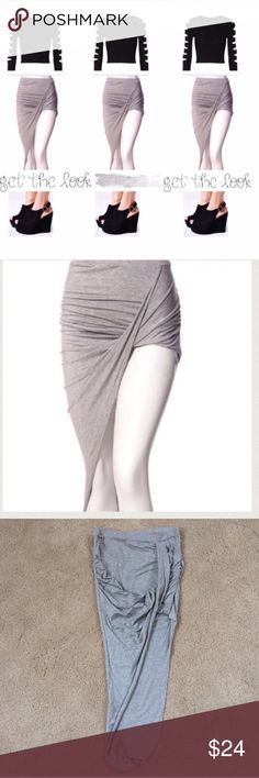 "NEW Cotton Asymmetrical Skirt NEW ✨This gorgeous asymmetrical drape skirt features an 11"" elastic waist band and hem detail. 95% rayon 5% spandex; Color: Heather Gray. Small size- stretchy! Super flattering Dresses Asymmetrical"