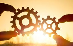 Two hands holding gears together. puzzle details on a sunset background. Close-up. Teamwork, partnership, business, cooperation and management concept. Small Business Management, Mba Degree, School Application, Sunset Background, Business School, Infographic Templates, Teamwork, Online Courses, Photo Editing