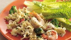 Every bite of pasta, seafood and broccoli is coated in a creamy Alfredo sauce.
