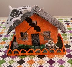 Vintage Putz Style Spooky Lighted Halloween Retro Glitter House Ornament with Bats Bones Skulls Skeletons Tombstones. $28.00, via Etsy.