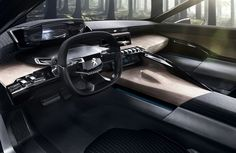 """Peugeot is showcasing its exciting EXALT concept in a new livery at the forthcoming Paris Motor Show. Unveiled first at the 2014 Beijing Motor Show, the EXALT is powered by a petrol 340bhp HYbrid4 drive train and blends a bare steel exterior and distinctive shark skin rear end. In the latest version, designers have uniquely used """"newspaper wood"""" in the interior, showcasing Peugeot's vision of sourcing local materials and recycling-based production. The tailgate features an ingenious opening…"""