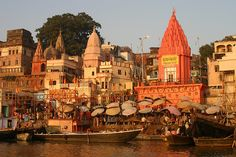 Varanasi , India . Situated on the banks of the River Ganges, Varanasi is sacred to Hindus, Buddhists and Jains and also one of the oldest continuously inhabited cities in the world. In many ways Varanasi epitomizes the very best and worst aspects of India, and it can be a little overwhelming. The scene of pilgrims doing their devotions in the River Ganges at sunrise set against the backdrop of the centuries old temples is probably one of the most impressive sights in the world.