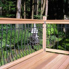 BuildDirect – Wood Railing Kits - Tuscany Series – Pine - Curved Black Baluster - Outdoor View