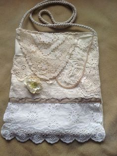 Up cycled bag made of lace, doilies and vintage jewellery.