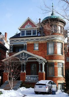 A nice old brick Victorian in Toronto.  Typical cake details are picked out so you can see the craftsmanship.  Wonderful round 3-story tower!