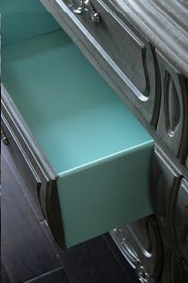 gray dresser with turquoise drawers