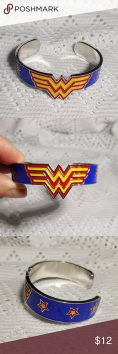 Wonder Woman Cuff Bracelet 100% New. Wonder Woman DC Comics metal cuff bracelet blue, red, yellow.  This beauty will stand out your Wonder Woman costume for parties or Halloween. If you are a fanatic of Wonder Woman this beautiful bracelet it's for you!  Colors: Mixture of Blue, Yellow, Red.  Vivid colors!  Size:  6.3 x 47cm Weight:  29.6g  Please feel free to contact me anytime for any questions.    Thank you for visiting Genelies Treasure Genelies Treasure Jewelry Bracelets