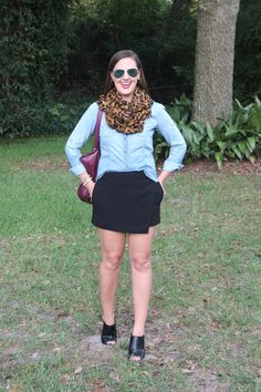 Leopard scarf, chambray shirt, black skort and mules via With Style and a Little Grace