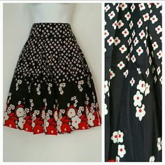 """Classy Floral skirt NWT Brand new with tags A classy floral skirt Black, red and white colors 100% cotton Approx 24"""" long Zips up on side Seen in picture 4, there are some manufacture defects such as the line you see in pic 4, going through tje flowers on this skirt, skirt is priced at a discount for the manufacture blemishes. Skirts A-Line or Full"""