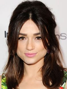 Long Haircuts for Triangle Shaped Faces: Curtain Bangs, Crystal Reed - If you don't love the idea of having thick bangs on your forehead 24/7, go for curtain bangs. They'll create weight and volume on either side of your forehead, while staying super low maintenance.