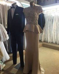 This elegant mother of the bride evening gown has a cute peplum design. We can make custom #motherofthebridedresses like this for you with any design modifications you need to make it your own. Our firm specializes in custom #eveningdresses that you can afford. We can also make #replicadresses of any couture design that will look the same but cost way less. For more info and priceing please go to www.dariuscordell.com/