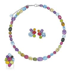 Asprey A Suite of Multi-Gem Jewelry Comprising a necklace, designed as a line of oval and circular-cut amethyst, blue-topaz, peridot, citrine and tourmaline; and a pair of earclips and ring en suite, mounted in 18K white gold, necklace length 15 3/4 inches, earclips length 1 inch, ring size 6. Signed 'Asprey' 'Italy' Estimate $13,000 - 18,000 Sold for $30,000