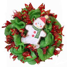 Christmas Wreath Tutorial using Deco Poly Mesh, Pencil Ball Wreath and large RAZ Frosted Cookie Ornaments ....see more images and instruction on the Trendy Tree Blog http://www.trendytree.com/blog/deco-poly-mesh-wreath-tutorial-using-raz-cookie-decorations/