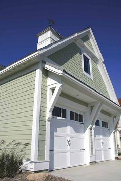 love the weather vane & carriage house doors