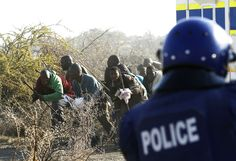 Marikana: A year on   Moments before the massacre, mine workers confront police. Photo: Siphiwe Sibeko, Reuters