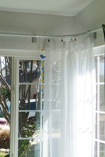 Ikea KVARTAL corner curtain rail by motoko smith. This is the same system, but mounted on the wall and not the ceiling. Corner Window Treatments, Corner Window Curtains, Ikea Curtains, Hanging Curtains, Window Coverings, Corner Windows, Patio Curtains, Bedroom Curtains, Windows