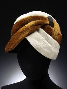 Hat   Antonio Castillo (Spanish, 1908-1984) for Lanvin   Made in Paris ca. 1955   Material: plush   Cross-over swathed hat in brown and white plush   VA Museum, London
