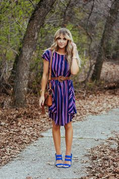 Cara Loren is looking cute and stylish in this gorgeous statement mini dress, worn with bright blue heels and a leather belt for an enhanced silhouette. We love this simple style for a great every day look. Dress: Shabby Apple.