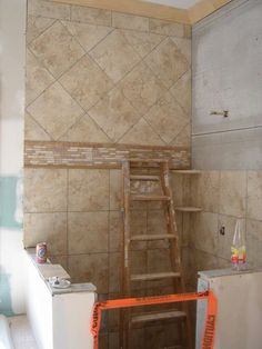 Bathroom Shower Tile- Natural tones, accent border mosaic with 12x12 (top diagonal & bottom straight)