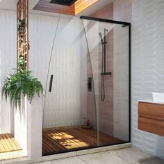 """The frameless sliding shower door features stunning, curved glass and exquisite header-less design. The unique shape is reminiscent of a waterfall, allowing subtle sophistication to flow effortlessly throughout the model. It showcases a patented, reversible L-Bar and integrated, state-of-the-art rollers for smooth and quiet operation. Make a statement with this shower door, the epitome of elegance and modern design aesthetics! Finish: Satin Black 