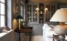 <3 grey built-ins, sconces and lamps