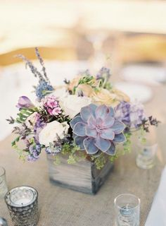The flowers are too pale but I love the wooden planter. Pretty succulent bouquet