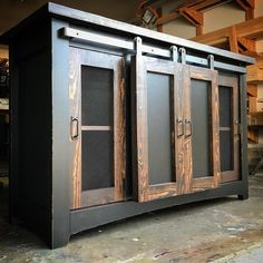 5' sliding barndoor console with recessed side hinged doors. Combo finish with Kona and Tricorn black 😍 #slidingbarndoor #barndoorconsole #custombuilt #oklahoma #buylocal #tulsa #brokenarrow #bixby