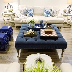 Family room living room blue decor | large tufted ottoman Restoration Hardware English Roll arm sofa couch |  garden stools marble side end tables | Classy Glam Living